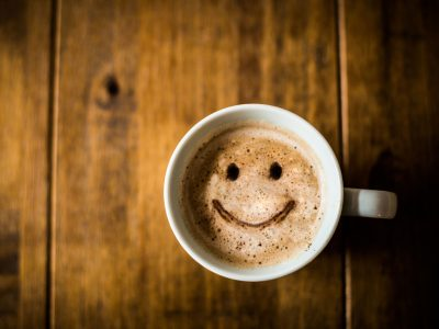 cup of coffee with a smiley face