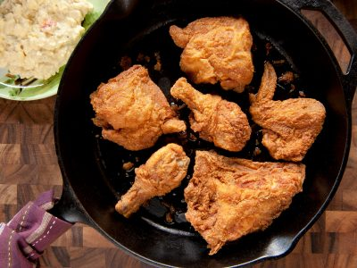 Rouses deli fried chicken in black iron skillet