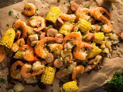 shrimp boil with mini corn on brown paper
