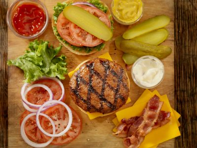 hamburger toppings, dill pickle slices with tomatoes and lettuce, open faced hamburger,