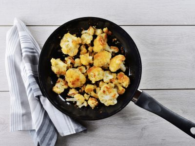 cauliflower bites appetizer in black iron skillet, eat right with Rouses