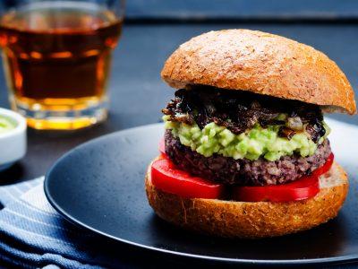 vegan hamburger mushrooms guacamole and tomato slices