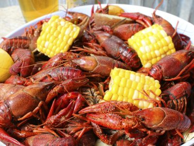 cooked crawfish and mini ears of corn
