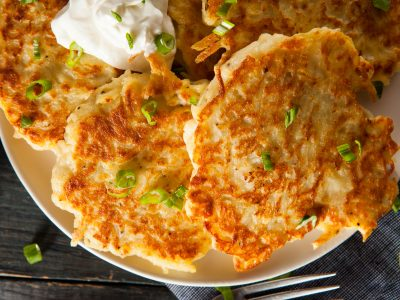 homemade fried latkes with sour cream