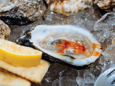 Denny Culbert photo of Gulf Oyster with hot sauce and crackers and lemon