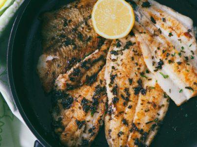 cooked flounder black skillet