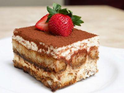 tiramisu slice topped with strawberry